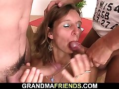 Hairy elderly mature lady swallows 2 cocks at once